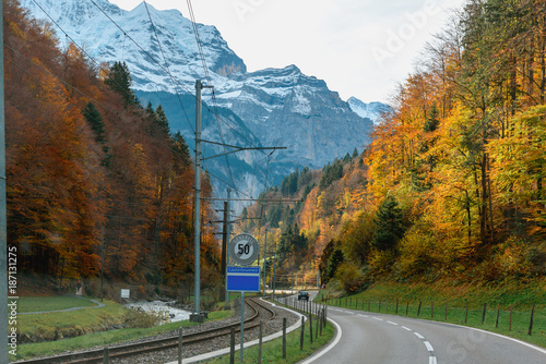 Beautiful view country road in Switzerland during autumn - 187131275