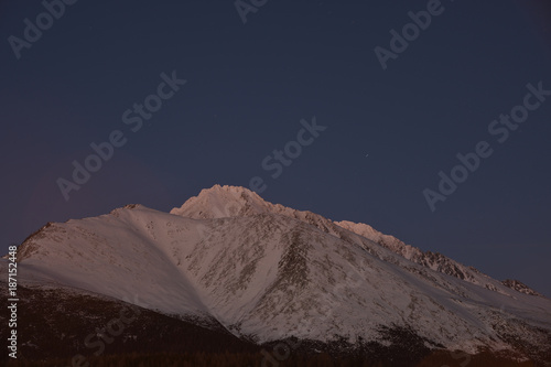 Fotobehang Nachtblauw scenery of snow covered High Tatras mountains in the night in Slovakia