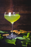 Green cocktail on the background of a wooden background. - 187162881
