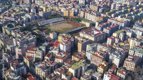 Fotobehang Napels Aerial view of the Collana Stadium in the Vomero district in Naples, Italy. The sports field now hosts football and rugby matches and training. Around the structure there are many buildings.