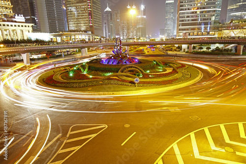 the light trails on the modern building background in shanghai china - 187167891