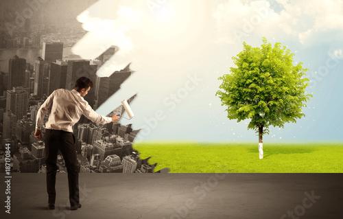 Foto Murales Salesman painting tree instead of city
