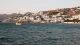 wide angle view of a sailing boat and the harbor at chora, mykonos in the late afternoon - 187177882