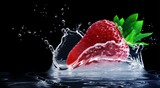 strawberry splashing in the water on black background