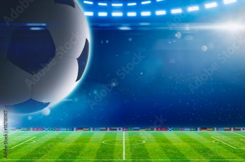 Staande foto Bol Big soccer ball above green stadium with bright spotlights