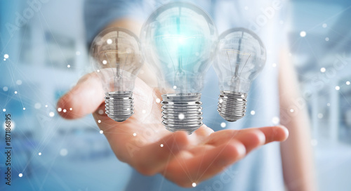 Foto Murales Businessman connecting modern lightbulbs with connections 3D rendering