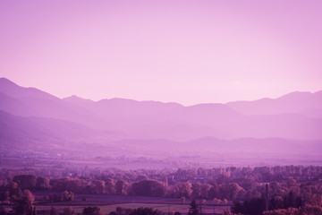 Beautiful Pyrinees mountain landscape at the golden hour from the pictoresque town of Puigcerda in Catalonia, Spain. Ultra Violet style