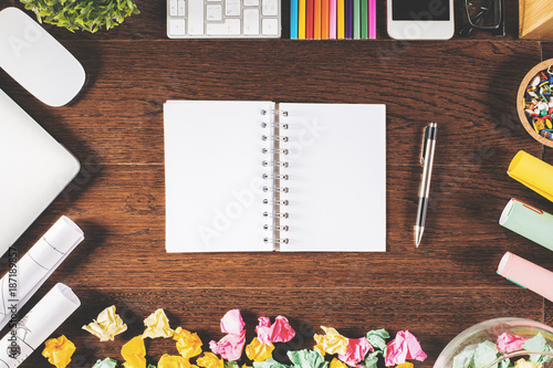 Table with empty notepad and objects