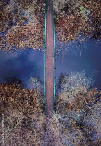 Wood bridge path on a river. - 187190683