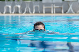Woman are swimming for exercise in the pool. - 187191641