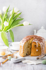 Sliced easter orthodox sweet bread, kulich with white tulips. Breakfast.