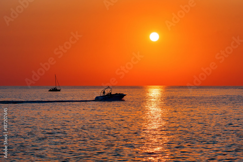 Fotobehang Oranje eclat Summer. Sea. Sunset on the Black sea. Sochi. Krasnodar Krai. Russia. Yachts floating on the sea.