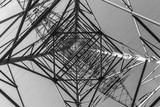 electric pylons transporting electricity through high tension cables - 187210053