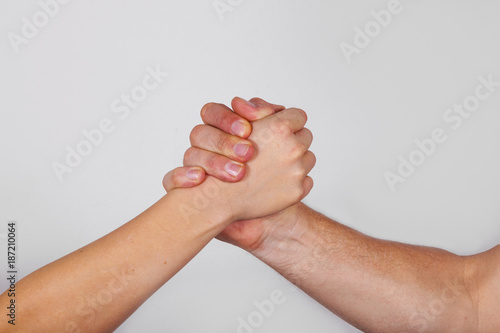 hand in hand symbolize teamwork and trust