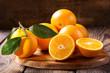Quadro fresh orange fruits with leaves