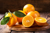 fresh orange fruits with leaves - 187213012