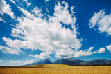 Fantastic view the white bright clouds in the clear blue sky. Wonderful skyscape under the Tatras Mountains in Slovakia. Ideal background for illustrations and collages.