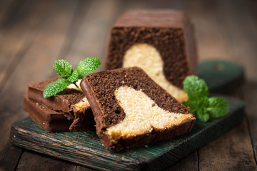 Homemade marble pound cake on a wooden board