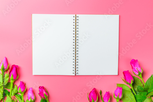 Pink roses decorative with blank notepad on top view flat lay for your text,for valentine and wedding sweet love concept vintage tone on pink background - 187227246