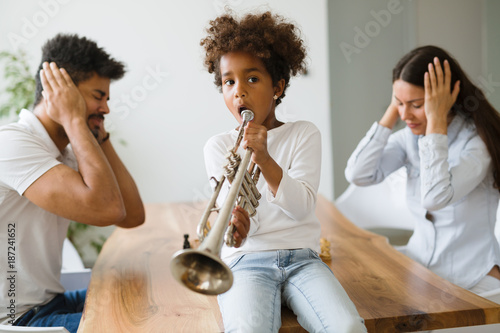 Foto Murales Picture of child making noise by playing trumpet