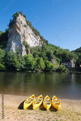 Fotobehang Landschappen River the Dordogne with canoes for rent