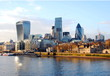 View of the financial district of london from the Thames River at sunset