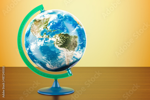 Geographical globe of planet Earth on the wooden table. 3D rendering
