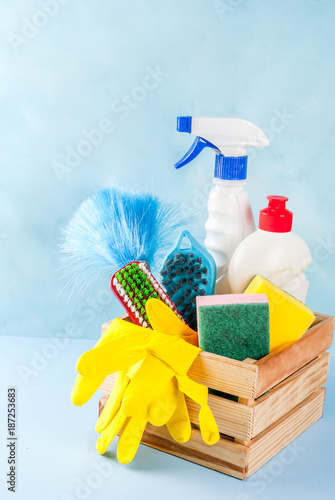 Foto Murales Spring cleaning concept with supplies, house cleaning products pile. Household chore concept, on light blue background copy space