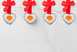 Real sushi set for valentine's day in form of hearts, with red ribbon and bow. White marble background copy space top view - 187253835
