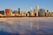 Winds and bitter cold with wind chill factors exceeding minus 20 degrees created vapor both above the forming ice in Lake Michgan in front of the Chicago skyline.