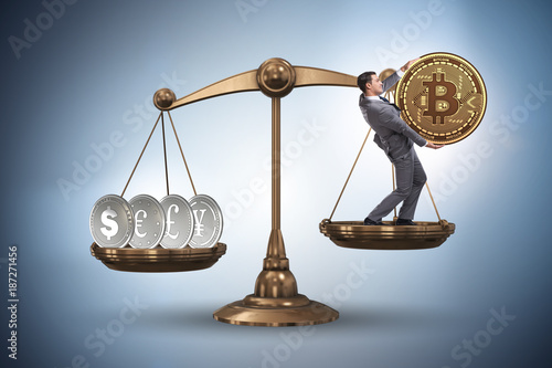Foto Murales Businessman on scales with bitcoins and other currencies
