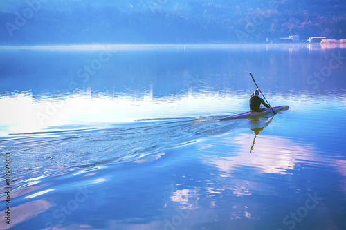 Fotobehang Zeilen man in a canoe