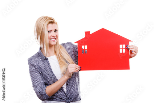 Woman holding red paper house symbol