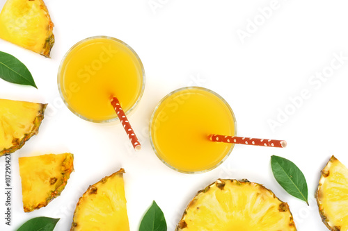 pineapple juice in a glass and pineapple slices isolated on white background with copy space for your text. Top view