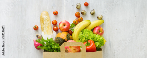 Top view paper bag of different fresh health food