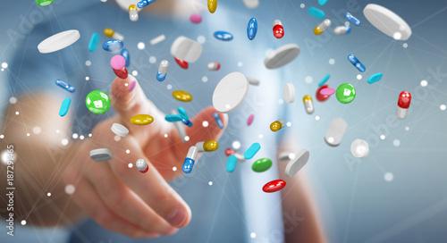 Papiers peints Kiev Businessman holding and touching floating medicine pills 3D rendering