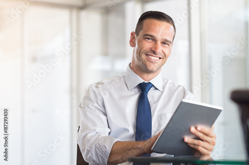 Business man using digital tablet
