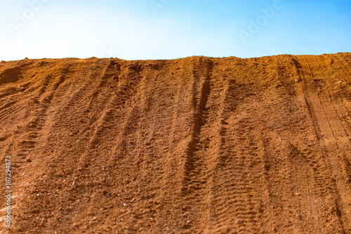 Traces from the car on the red clay soil