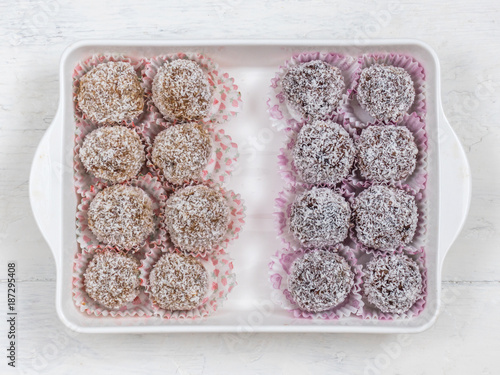 Foto Murales Homemade healthy and natural sweets made of dates, nuts and coconut