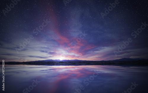 Foto Murales idyllic sunrise in the sky reflecting on calm water
