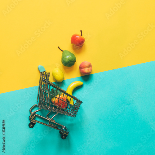 Self-service supermarket full shopping trolley cart with fresh grocery products and fuit - 187299890