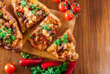 Sliced traditional Turkish pide with meat and vegetables - 187300078