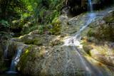 Waterfall hidden in the tropical jungle (erawan waterfall) in kanchanaburi province asia southeast asia Thailand
