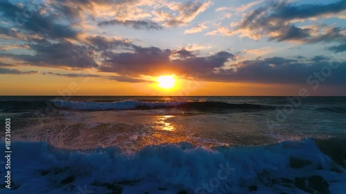 Aerial view of beautiful sunrise with dramatic cloudscape over the sea video