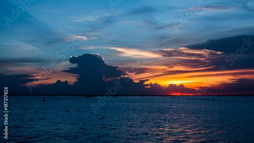 Fotobehang Blauwe jeans Beautiful sunset above sea in thailand,