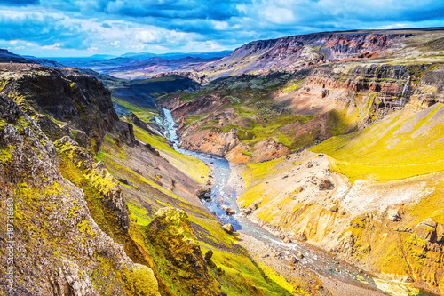 Fotobehang Oranje Picturesque landscape of a mountain river with traditional nature of Iceland.