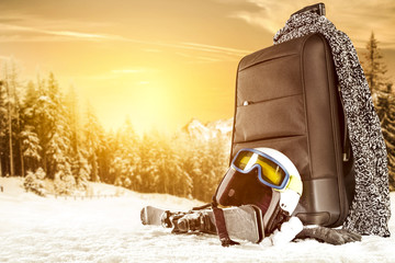 winter time and suitcase on snow space