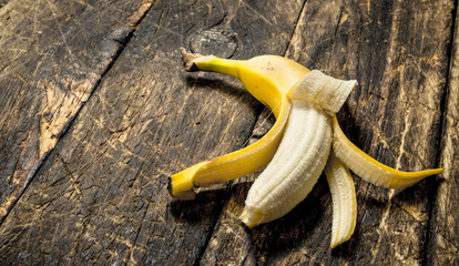 Ripe banana. On wooden background.