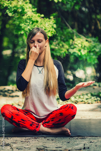 Foto op Aluminium School de yoga Pranayama. Alternate nostril breathing exercise in yoga