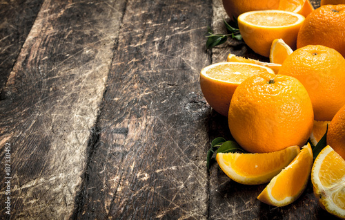 Fresh oranges with leaves. - 187330452
